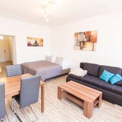Апартаменты Checkvienna – Apartment Huetteldorfer Strasse Вена комната для гостей фото 5