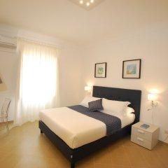 Отель Lemòni Suite Сиракуза комната для гостей фото 3