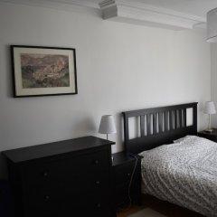 Апартаменты Charming 1 Bedroom Apartment With Balcony сейф в номере