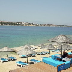 Kamer Suites & Hotel Чешме пляж