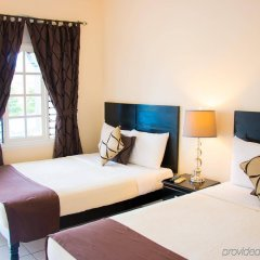 Отель Travellers Beach Resort комната для гостей фото 2