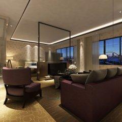 Huahai Business Hotel Airport Branch комната для гостей