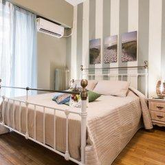 Отель Charming Acropolis Metro Apartment Греция, Афины - отзывы, цены и фото номеров - забронировать отель Charming Acropolis Metro Apartment онлайн комната для гостей