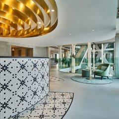 Отель QO Amsterdam Нидерланды, Амстердам - 1 отзыв об отеле, цены и фото номеров - забронировать отель QO Amsterdam онлайн фитнесс-зал фото 2