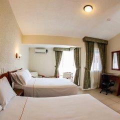 Отель Estancia Мексика, Гвадалахара - отзывы, цены и фото номеров - забронировать отель Estancia онлайн сейф в номере