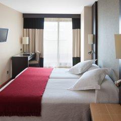 Отель NH Ciudad de Valencia комната для гостей