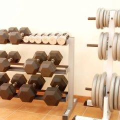Отель Al Liwan Suites фитнесс-зал фото 3