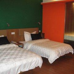 Отель Gangding Garden Inn комната для гостей