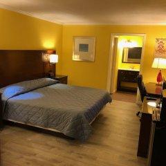 Отель Dragon Inn & Suites комната для гостей фото 5
