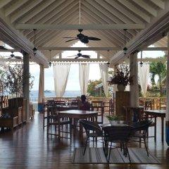 Отель Beachcombers Hotel Сент-Винсент и Гренадины, Остров Бекия - отзывы, цены и фото номеров - забронировать отель Beachcombers Hotel онлайн питание фото 2