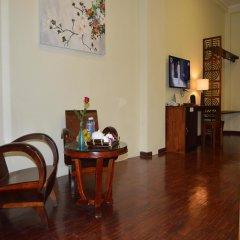 Отель Orchids Homestay Хойан удобства в номере