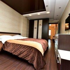 Апартаменты Inzhir Na Vorovskogo 20 Apartments Сочи комната для гостей фото 2