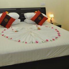 Отель Charming Holiday Lodge Мальдивы, Хулхудху (Атолл Адду) - отзывы, цены и фото номеров - забронировать отель Charming Holiday Lodge онлайн Хулхудху (Атолл Адду) сейф в номере