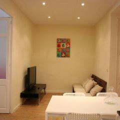 Апартаменты Avenida Apartments Piquer комната для гостей фото 4