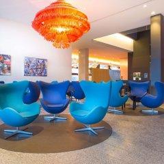 Отель Radisson Blu Hotel Zurich Airport Швейцария, Цюрих - 1 отзыв об отеле, цены и фото номеров - забронировать отель Radisson Blu Hotel Zurich Airport онлайн интерьер отеля фото 2