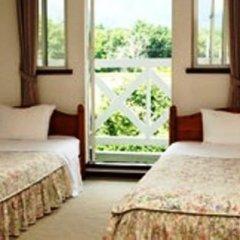 Отель Pension Angelica Минамиогуни комната для гостей фото 2