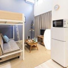 Отель Trip Pod Sumiyoshi B Хаката комната для гостей фото 5