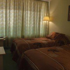 Гостиница Мирный курорт комната для гостей фото 5