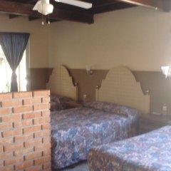 Отель Don Eddie's Landing комната для гостей