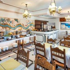 Отель Astir Thira Греция, Остров Санторини - отзывы, цены и фото номеров - забронировать отель Astir Thira онлайн питание фото 3