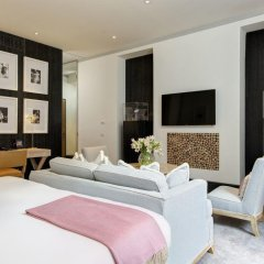 Отель Portrait Suites комната для гостей фото 4