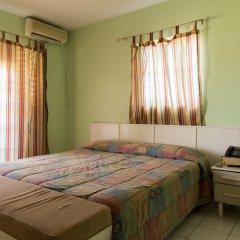 Отель Donway, A Jamaican Style Village Ямайка, Монтего-Бей - отзывы, цены и фото номеров - забронировать отель Donway, A Jamaican Style Village онлайн комната для гостей фото 2