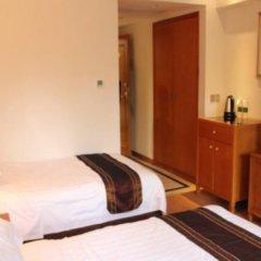 Отель Customs Hotel Китай, Гуанчжоу - отзывы, цены и фото номеров - забронировать отель Customs Hotel онлайн удобства в номере фото 2