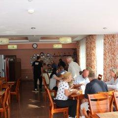 Отель Tagaitai Guest House Кыргызстан, Каракол - отзывы, цены и фото номеров - забронировать отель Tagaitai Guest House онлайн питание фото 3
