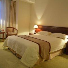 Отель Shanghai Airlines Travel Hotel Китай, Шанхай - 1 отзыв об отеле, цены и фото номеров - забронировать отель Shanghai Airlines Travel Hotel онлайн комната для гостей фото 7