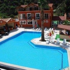 Akdeniz Beach Hotel Турция, Олюдениз - 1 отзыв об отеле, цены и фото номеров - забронировать отель Akdeniz Beach Hotel онлайн бассейн фото 2