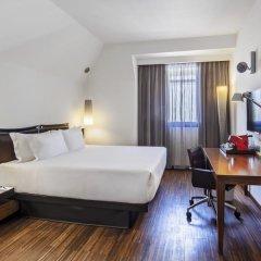 Отель NH Milano Touring 4* Улучшенный номер разные типы кроватей фото 39