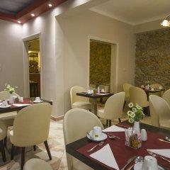 Отель Ambrosia Suites & Aparts питание фото 3