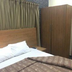 Отель Grand Riviera Suites Энугу комната для гостей фото 3