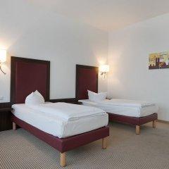 Отель AZIMUT Hotel Munich Германия, Мюнхен - 10 отзывов об отеле, цены и фото номеров - забронировать отель AZIMUT Hotel Munich онлайн комната для гостей фото 5