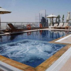 Отель MENA ApartHotel Albarsha бассейн фото 2