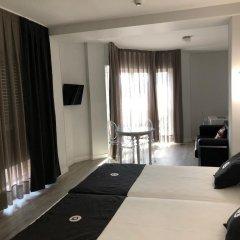 Отель Aparthotel Quo Eraso Мадрид комната для гостей фото 3