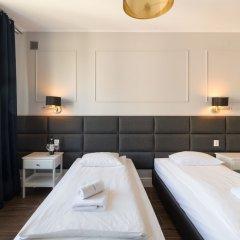 Отель Executive 3 Bedroom Apartament by Your F Польша, Варшава - отзывы, цены и фото номеров - забронировать отель Executive 3 Bedroom Apartament by Your F онлайн комната для гостей