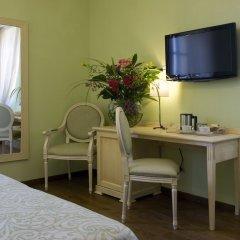 Отель Relais Corte Cavalli Понти-суль-Минчо удобства в номере фото 2