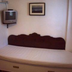 Отель Ecoxenia Studios сейф в номере