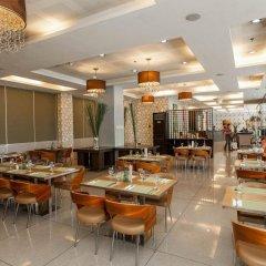 Отель Diamond Suites And Residences Филиппины, Лапу-Лапу - 1 отзыв об отеле, цены и фото номеров - забронировать отель Diamond Suites And Residences онлайн питание фото 2