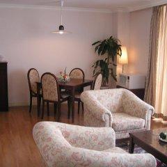 Апартаменты Saigon Court Serviced Apartment Хошимин комната для гостей