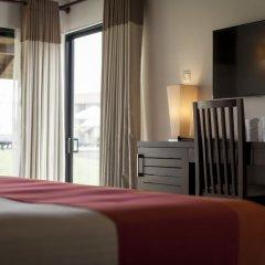 Отель The Calm Resort & Spa удобства в номере фото 2