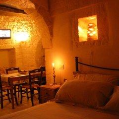 Отель Trulli Resort Monte Pasubio Альберобелло в номере фото 2