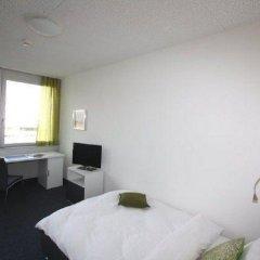 Отель Primestay Apartmenthaus Zurich Seebach Швейцария, Цюрих - отзывы, цены и фото номеров - забронировать отель Primestay Apartmenthaus Zurich Seebach онлайн комната для гостей фото 5