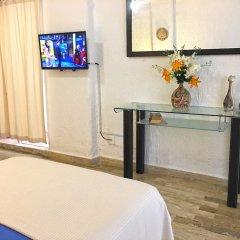 Отель Cancun Plaza Condo удобства в номере