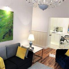 Апартаменты MONDRIAN Luxury Suites & Apartments Warsaw Market Square комната для гостей фото 3
