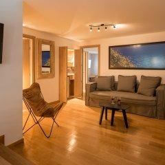 Отель Fos DownTown Suites Афины комната для гостей фото 9