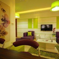 Отель Aqarco Shmaisani Apartment Иордания, Амман - отзывы, цены и фото номеров - забронировать отель Aqarco Shmaisani Apartment онлайн комната для гостей фото 2
