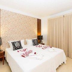 Апартаменты Oura View Beach Club Apartments комната для гостей фото 3
