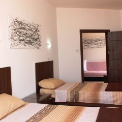 Отель Seashells Penthouse Буджибба комната для гостей фото 3